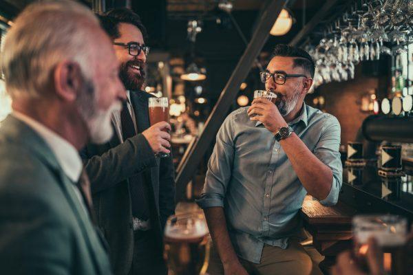Businessmen socializing at the bar after work